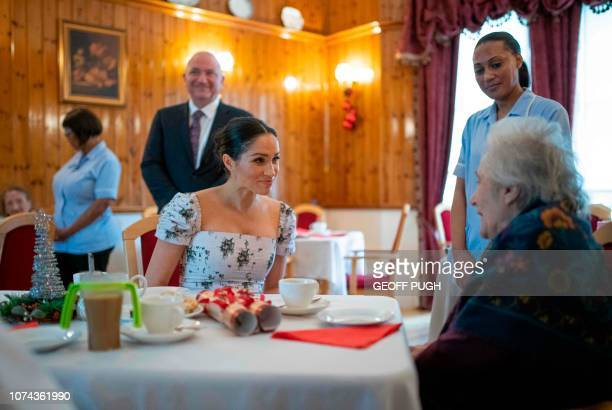 Britain's Meghan Duchess of Sussex chats with actress Josephine Gordon during a visit to the Royal Variety Charity's residential nursing and care...