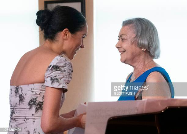 Britain's Meghan Duchess of Sussex chats with actress Rosario Serrano during her visit to the Royal Variety Charity's residential nursing and care...