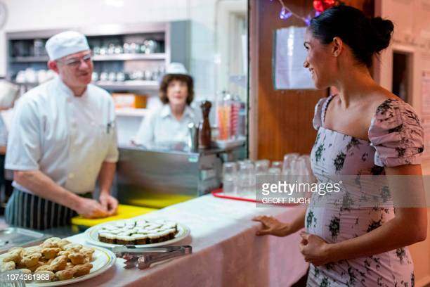 Britain's Meghan Duchess of Sussex chats with head chef Stuart Jones during a visit to the Royal Variety Charity's residential nursing and care home...