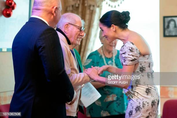 Britain's Meghan Duchess of Sussex chats with Reg Brigden during her visit to the Royal Variety Charity's residential nursing and care home...