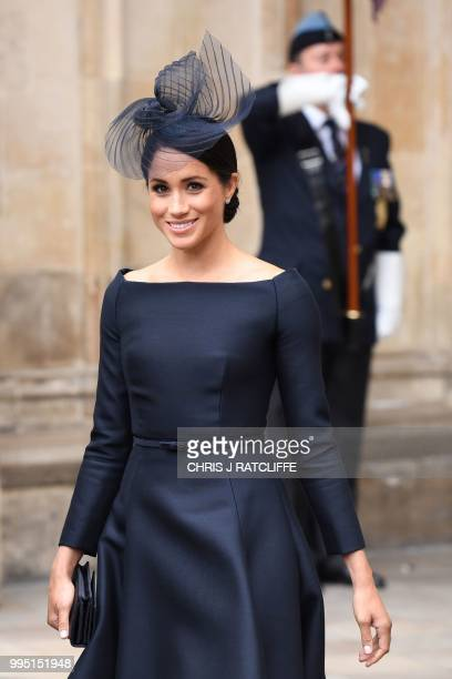 Britain's Meghan Duchess of Sussex leaves a service to mark the centenary of the Royal Air Force at Westminster Abbey in central London on July 10...
