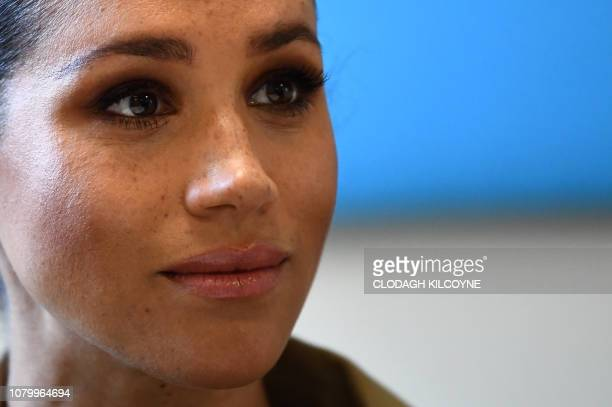 Britain's Meghan, Duchess of Sussex listens during her visit to Smart Works, a charity to which she has become patron, at St Charles hospital in west...