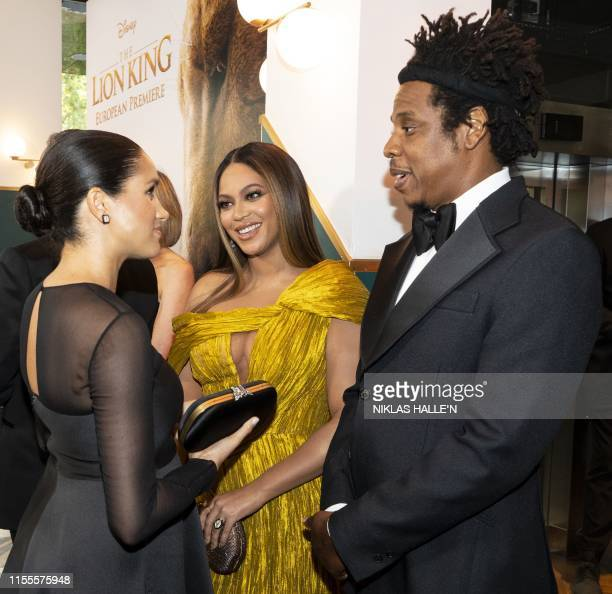 Britain's Meghan, Duchess of Sussex meets cast and crew, including US singer-songwriter Beyoncé and her husband, US rapper Jay-Z as she attends the...