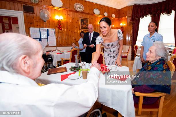 Britain's Meghan Duchess of Sussex meets residents on a visit to the Royal Variety Charity's residential nursing and care home Brinsworth House in...