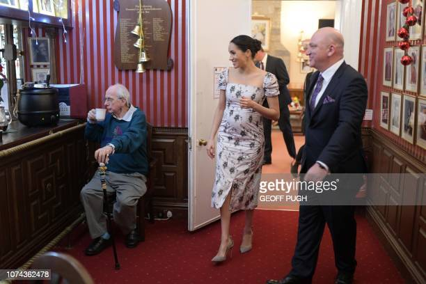 Britain's Meghan Duchess of Sussex meets with actor Richard O'Sullivan during her visit to the Royal Variety Charity's residential nursing and care...