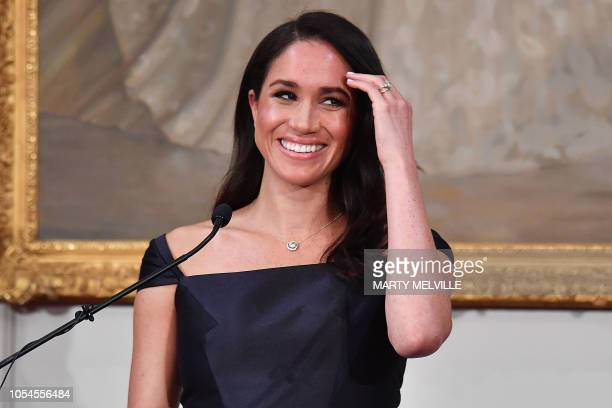 Britain's Meghan Duchess of Sussex reacts as she speaks to invited guests during a reception at Government House in Wellington on October 28 2018...