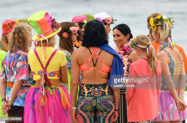 Britain's Meghan Duchess of Sussex talks to members after a Fluro Friday session run by OneWave a local surfing community group who raise awareness...
