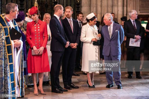 Britain's Meghan Duchess of Sussex talks with Britain's Prince Charles Prince of Wales Britain's Prince William Duke of Cambridge talks with...