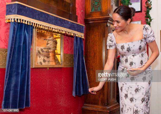 Britain's Meghan Duchess of Sussex unveils a plaque to commemorate her visit to the Royal Variety Charity's residential nursing and care home...