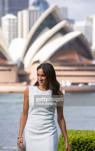 Britain's Meghan Duchess of Sussex waits for a photo opportunity with the Sydney Opera House in the background at Admiralty House in Sydney on...
