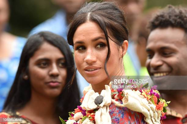 Britain's Meghan the Duchess of Sussex meets people at the University of the South Pacific in Suva on October 24 2018 British royal Meghan Markle...