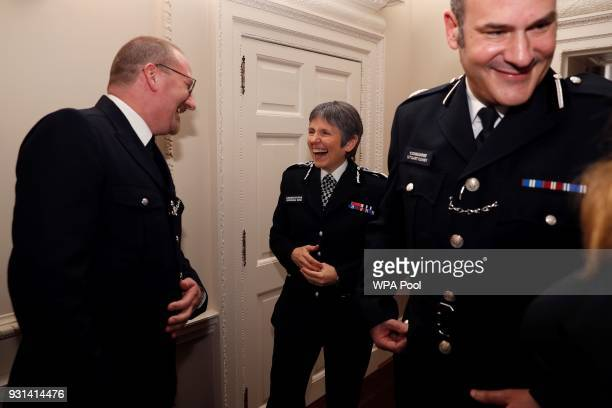 Britain's Metropolitan Police Commissioner Cressida Dick and Police commander Stuart Cundy react as they talk with police officer of the year PC...