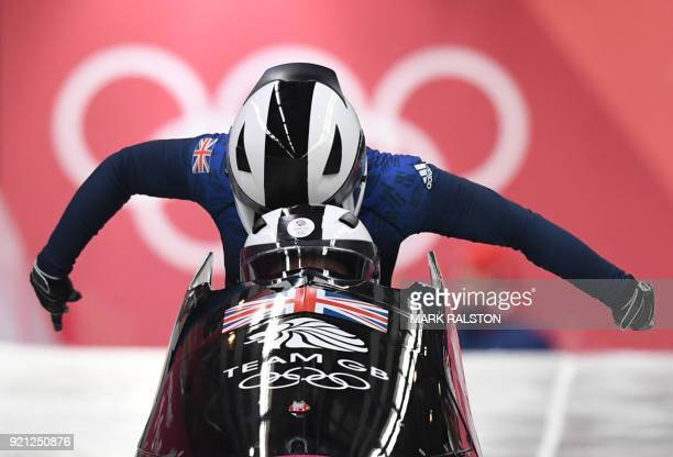 Britain's Mica Mcneill and Britain's Mica Moore compete in the women's bobsleigh heat 1 run during the Pyeongchang 2018 Winter Olympic Games at the...