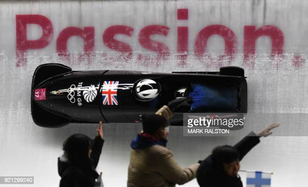 Britain's Mica Mcneill and Britain's Mica Moore compete in the women's bobsleigh heat 2 run during the Pyeongchang 2018 Winter Olympic Games at the...