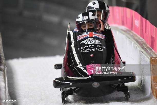 Britain's Mica Mcneill and Britain's Mica Moore compete in the women's bobsleigh heat 3 run during the Pyeongchang 2018 Winter Olympic Games at the...