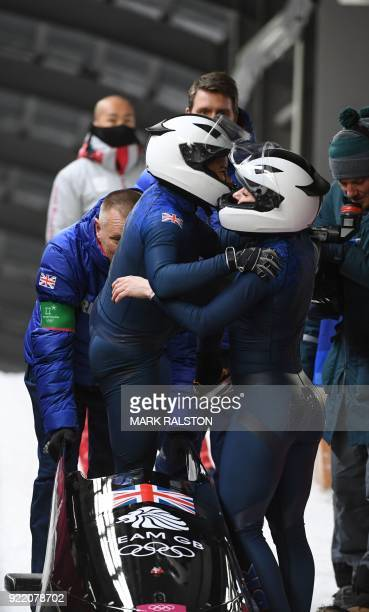 Britain's Mica Mcneill and Britain's Mica Moore compete in the women's bobsleigh heat 4 final run during the Pyeongchang 2018 Winter Olympic Games at...