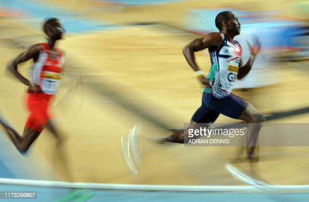 Britain's Michael Bingham runs ahead of Trinidad and Tobago's Jereem Richards during the men's 4x400m relay qualifications at the 2012 IAAF World...