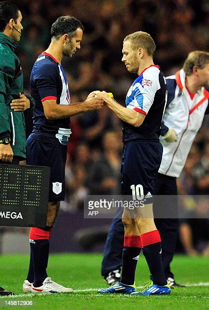 Britain's midfielder Ryan Giggs comes on as a substitute for striker Craig Bellamy during the London 2012 Olympic Games men's quarter-final football...