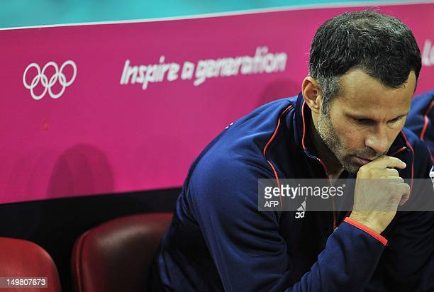 Britain's midfielder Ryan Giggs contemplates before the London 2012 Olympic Games men's quarterfinal football match between Britain and South Korea...