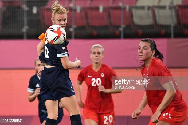 Britain's midfielder Sophie Ingle heads the ball during the Tokyo 2020 Olympic Games women's group E first round football match between Canada and...