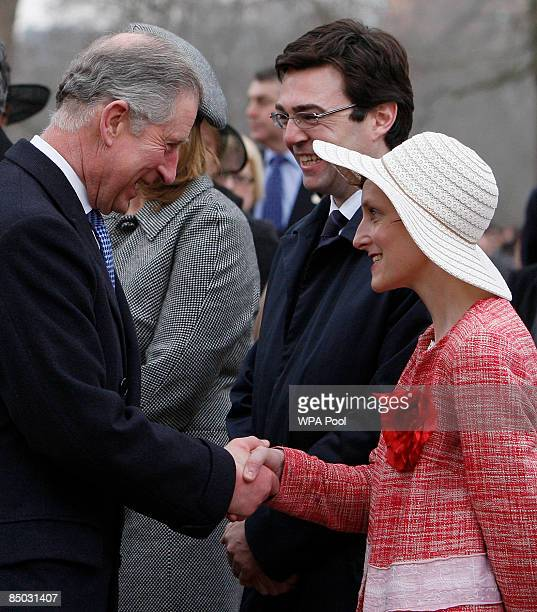 Britain's Minister for Culture Media and Sport Andy Burnham looks on as his wife MarieFrance van Heel shakes hands with Prince Charles the Prince of...