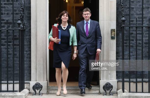 Britain's Minister of State at the Department for Business Energy and Industrial Strategy Claire Perry and Britain's Business Secretary Greg Clark...