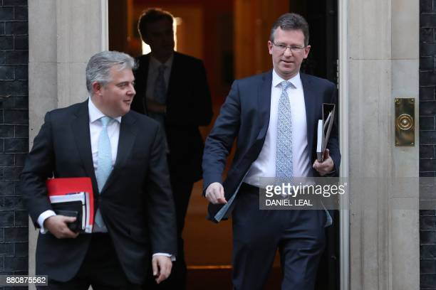 Britain's Minister of State for Immigration Brandon Lewis and Britain's Attorney General Jeremy Wright leave 10 Downing Street in central London on...