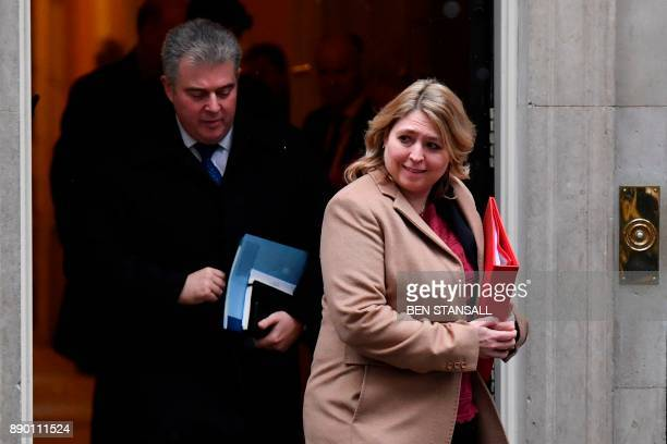 Britain's Minister of State for Immigration Brandon Lewis and Britain's Culture Media and Sport Secretary Karen Bradley leave 10 Downing Street after...