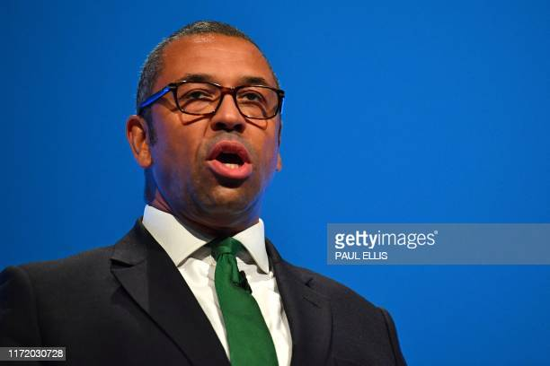 Britain's Minister without Portfolio and Conservative Party Chairman James Cleverly delivers a speech on the first day of the annual Conservative...