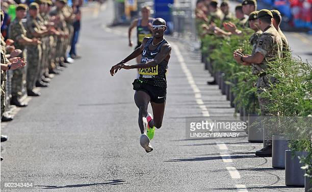 Britain's Mo Farah acts out a kick as he approaches the finish on his way to victory in the the men's elite race in the Great North Run halfmarathon...