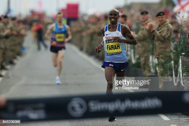 Britain's Mo Farah approaches the finish line to win the men's elite race of the Great North Run halfmarathon in South Shields north east England on...
