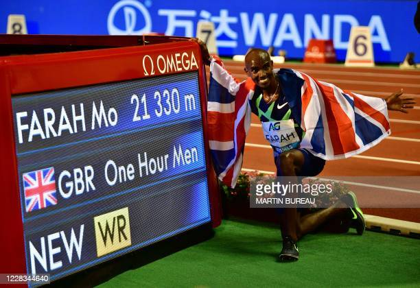 Britain's Mo Farah celebrates after victory and a world record in the men's one hour event at The Diamond League AG Memorial Van Damme athletics...