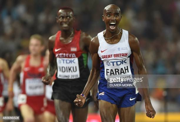 """Britain's Mo Farah celebrates as he wins the final of the men's 5000 metres athletics event at the 2015 IAAF World Championships at the """"Bird's Nest""""..."""