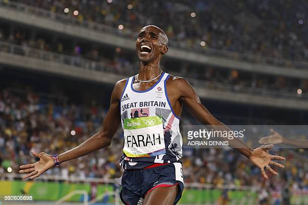 Britain's Mo Farah celebrates winning the Men's 5000m Final during the athletics event at the Rio 2016 Olympic Games at the Olympic Stadium in Rio de...