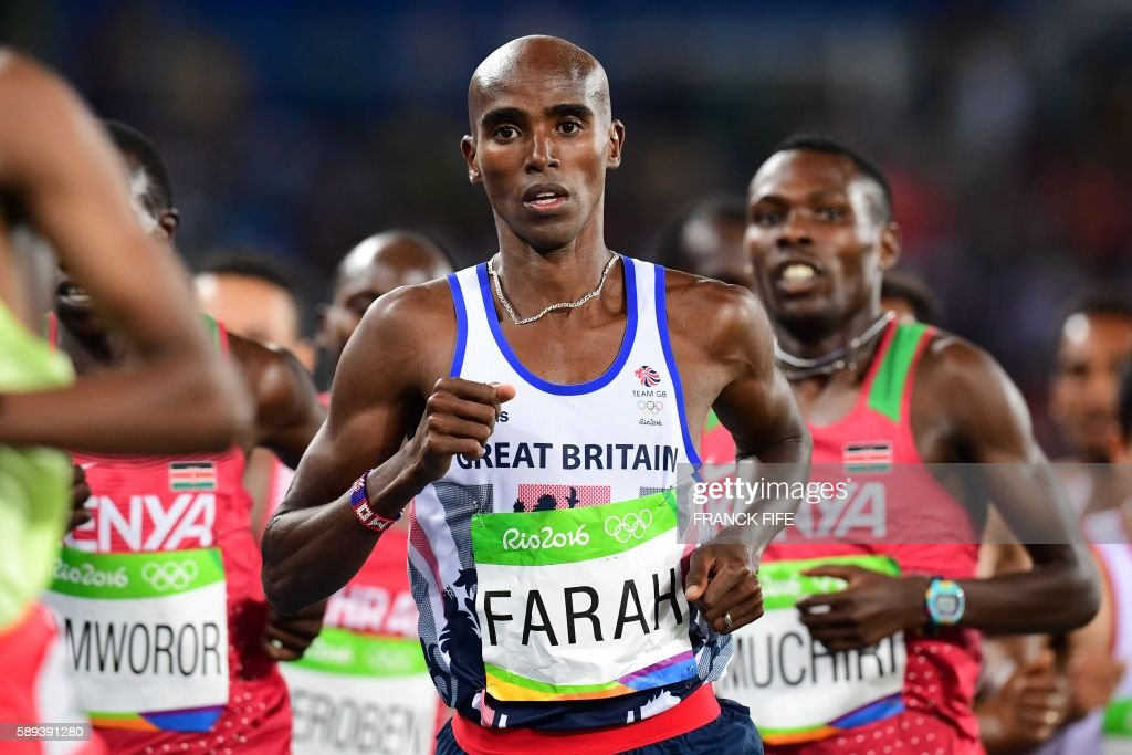 TOPSHOT - Britain's Mo Farah competes in the Men's 10,000m during the athletics event at the Rio 2016 Olympic Games at the Olympic Stadium in Rio de Janeiro on August 13, 2016. /