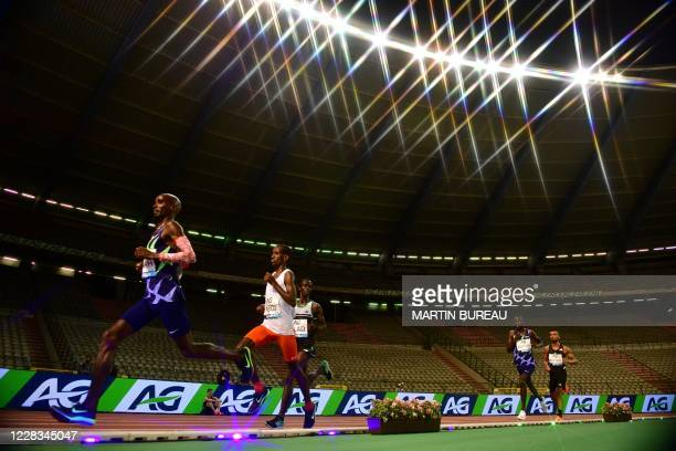 Britain's Mo Farah competes with Belgium's Bashir Abdi and others on his way to a world record in the men's one hour event at The Diamond League AG...