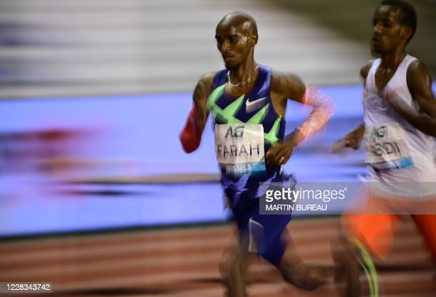 Britain's Mo Farah competes with Belgium's Bashir Abdi during the men's one hour event at The Diamond League AG Memorial Van Damme athletics meeting...