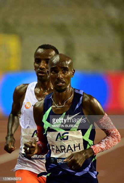 Britain's Mo Farah competes with Belgium's Bashir Abdi on his way to a world record in the men's one hour event at The Diamond League AG Memorial Van...