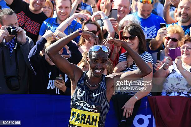 Britain's Mo Farah does his 'mobot' celebration after winning the men's elite race in the Great North Run halfmarathon in South Shields north east...