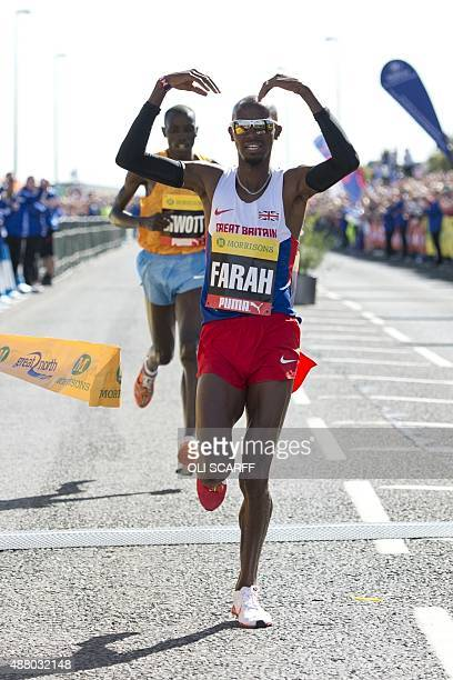 Britain's Mo Farah does his 'mobot' celebration as he wins the men's elite race in the Great North Run halfmarathon in South Shields north east...