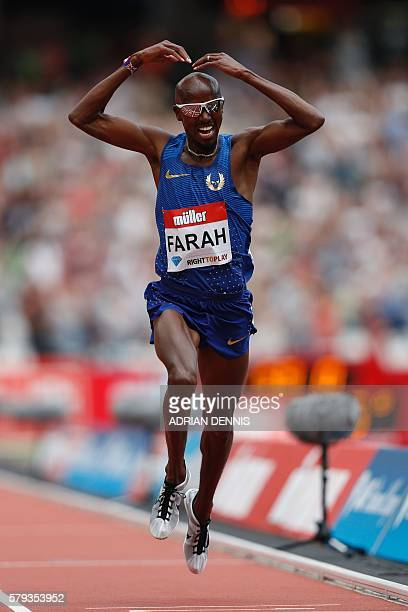 Britain's Mo Farah does his trademark 'mobot' gesture as he celebrates winning the men's 5000 metres during the IAAF Diamond League Anniversary Games...