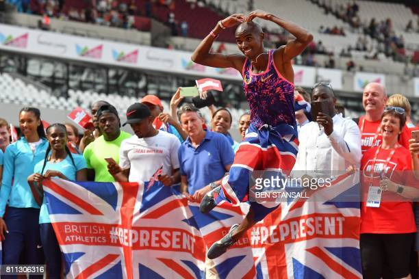 Britain's Mo Farah does the Mo Bot as he poses for a photograph with volunteers and IAAF president Seb Coe after the IAAF Diamond League Anniversary...
