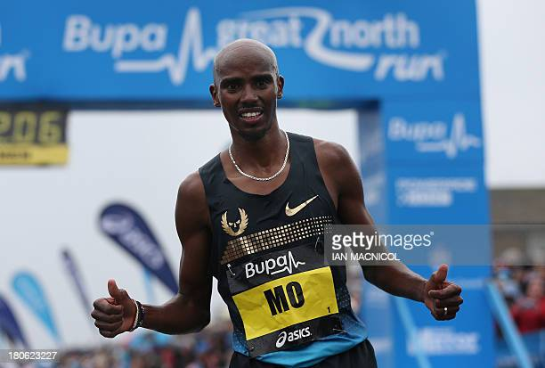 Britain's Mo Farah gestures after finishing second in the Great North Run half marathon in South Shields, near Newcastle in northeast England on...