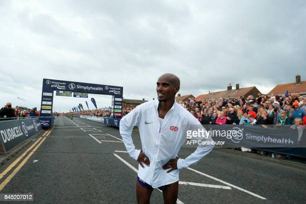 Britain's Mo Farah looks on after winning the men's elite race of the Great North Run halfmarathon in South Shields north east England on September...