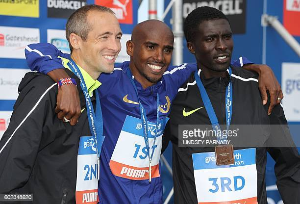 Britain's Mo Farah poses for a photograph with runnerup US runner Dathan Ritzenhein and third place runner Kenya's Emmanuel Bett after the men's...