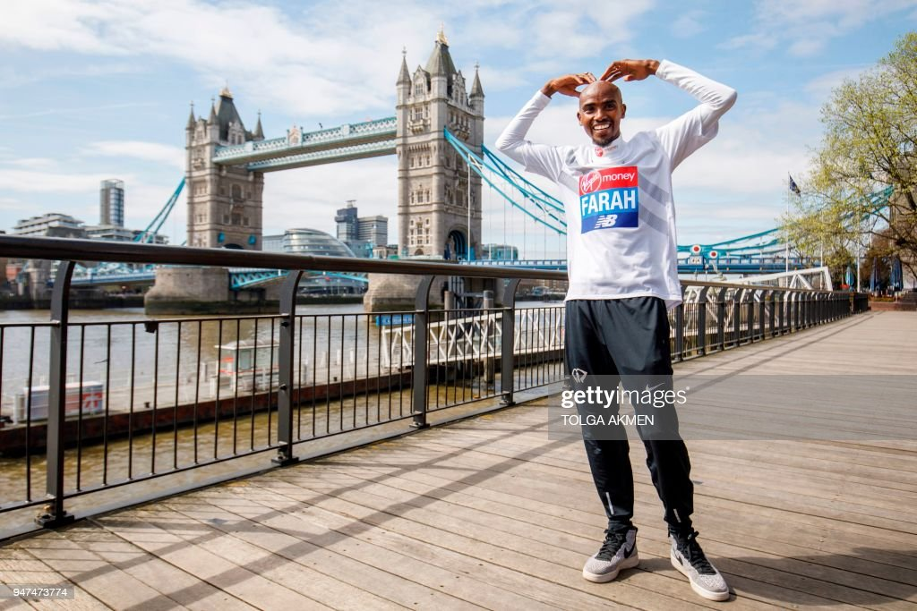 TOPSHOT - Britain's Mo Farah poses for the media during a photo call for the London marathon near Tower Bridge in London on April 17, 2018.