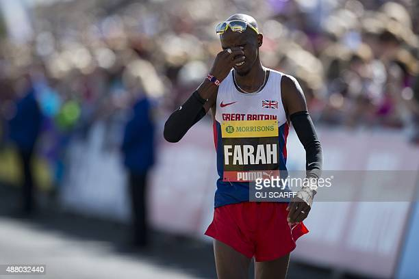 Britain's Mo Farah reacts after winning the men's elite race in the Great North Run halfmarathon in South Shields north east England on September 13...
