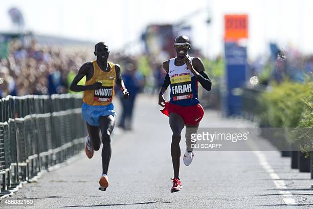Britain's Mo Farah wins the men's elite race ahead of second place finisher Kenyan Stanley Biwott in the Great North Run halfmarathon in South...