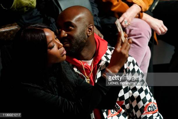 Britain's model and producer Naomi Campbell and US designer and DJ Virgil Abloh attend the Nike show to present feminine world soccer cup jerseys in...