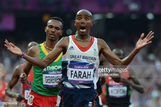 Britain's Mohamed Farah celebrates after winning the men's 5000m final at the athletics event of the London 2012 Olympic Games on August 11 2012 in...